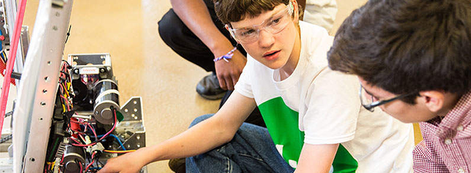 Image of boy learning science