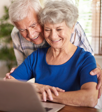Elderly couple using a laptop