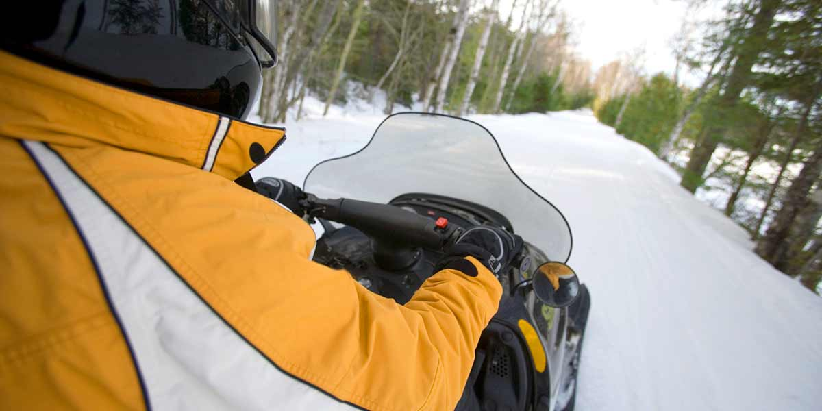 Image of person riding snow mobile